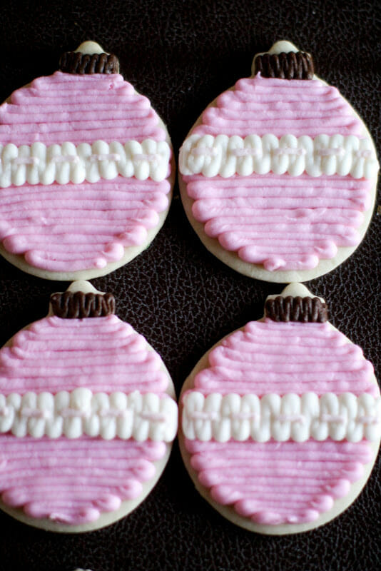 Whether you just love all things pink or you're celebrating a breast cancer survivor, these Pink Inspired Christmas Cookies are sure to bring joy and encouragement to your holiday table! || JennyCookies.com #christmas #christmascookies #breastcancerawareness #holidaycookies