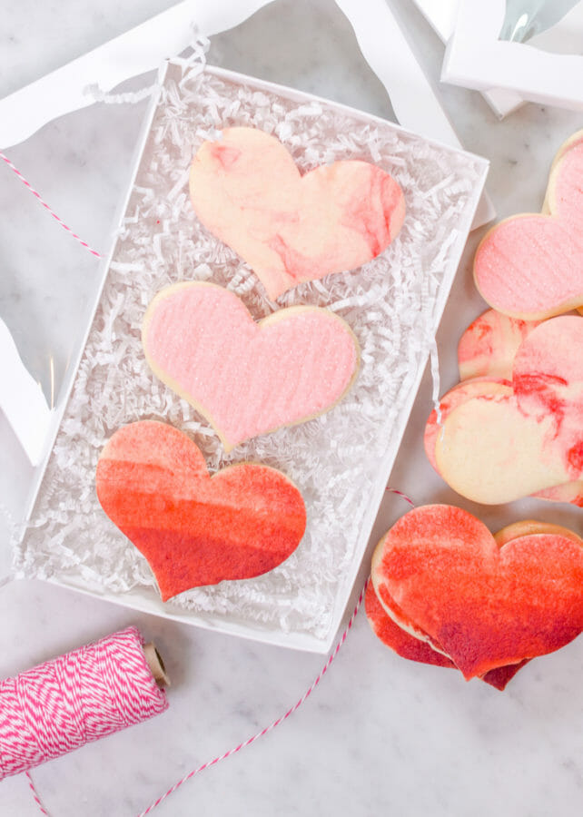 Buttercream Sugar Cookie Hearts | valentine sugar cookie recipes | valentine cookie recipes | buttercream icing for cookies | easy valentine desserts | how to frost valentine cookies || JennyCookies.com and @mccormickspices #buttercreamicing #valentinecookies #valentinedesserts