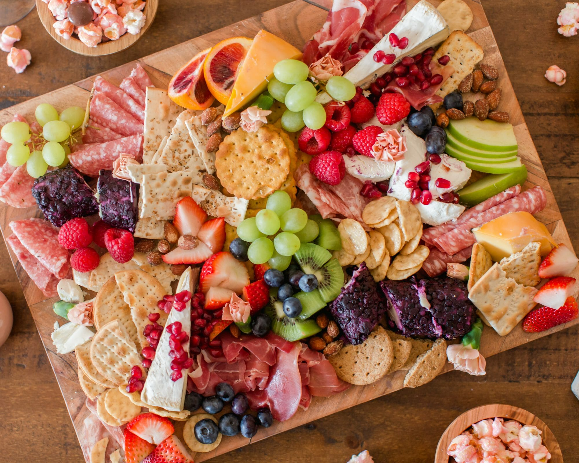 Here's how to host the ultimate girls night and ladies watch party including how to make charcuterie & charTREATerie boards! || JennyCookies.com #girlsnight #ladiesnight #watchparty #charcuterieboards #jennycookies